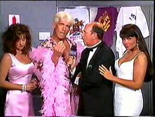 Gene Okerlund, Elizabeth, Ric Flair, and Woman