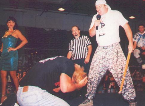 Mikey Whipwreck, The Sandman, Steve Austin, and Woman